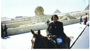 Debra Saletta in front of Great Sphinx of Giza with the Giza Necropolis in the background